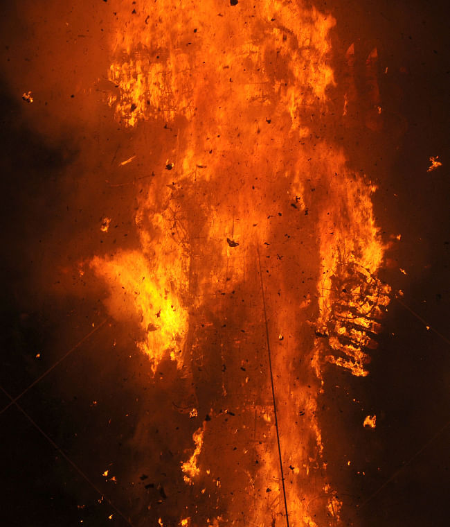 The Ravana effigy in flames, at the Dussehra celebrations, at Subhash Maidan, on the auspicious occasion of Vijay Dashmi, in Delhi on October 13, 2013