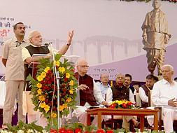 Gujarat Chief Minister Narendra Modi speaking after laying the foundation stone of the Statue of Unity at Kevadia in Gujarat. Former Deputy Prime Minister and senior BJP leader L K Advani is also seen.