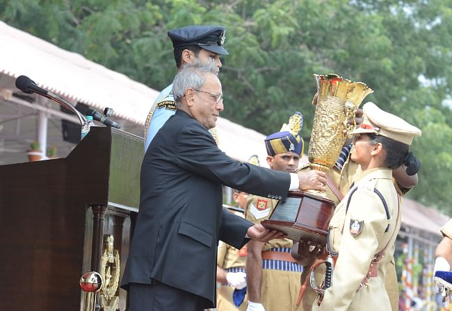 President Pranab Mukherjee presenting the trophy for best all rounder IPS officer trainee to Ms. Shalini Agnihotri at Sardar Vallabhai Patel National Police Academy, in Hyderabad on November 5, 2013.