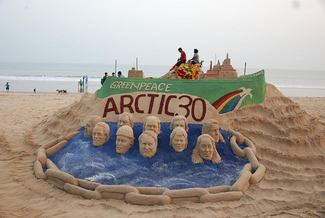 A view of the sand art created by artist Sudarshan Patnaik in support of the 30 Greenpeace activists arrested by Russian authorities in the Arctic, in Puri on November 8, 2013.