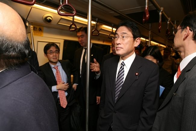 Japanese Foreign Minister Fumio Kishida travelling on a Delhi Metro train from Central Secretariat to Chawri Bazar and back to Patel Chowk station on November 12, 2013