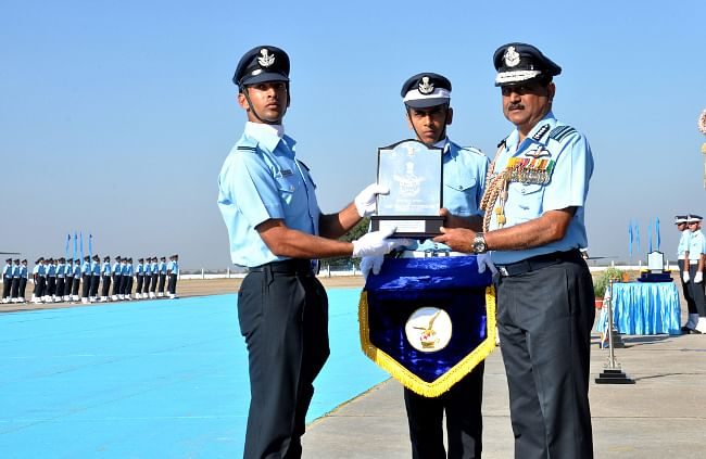 Chairman Chiefs of Staff Committee and Chief of the Air Staff, Air Chief Marshal N.A.K. Browne awarding the President's Plaque to Flying Officer Praveen Kumar for standing first in overall order of merit during Combined Graduation Parade, at Air Force Academy, Dindigul, on December 14, 2013.