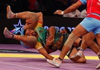 Patna's raider Ravi Dalal trying to escape Jaipur Pink Panthers' trap in the semi-final of the Star Sports Pro Kabaddi League in Mumbai on August 29, 2014