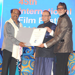 Renowned actor Amitabh Bachchan and Information & Broadcasting, Minister Arun Jaitley presenting the centenary award to Tamil megastar Rajinikanth, at the inauguration of the 45th International Film Festival of India, in Panaji, Goa on November 20, 2014.