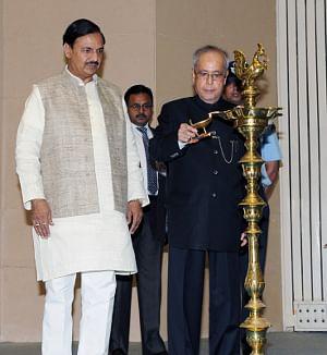 President Pranab Mukherjee lighting the lamp at the presentation of the National Tourism Awards 2013-14, in New Delhi on September 18, 2015.