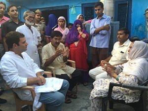 Congress Vice-President Rahul Gandhi meeting the family of Mohammad Akhlaq, who was lynched by a mob on Monday night for allegedly consuming beef, in Dadri, Uttar Pradesh on October 3, 2015