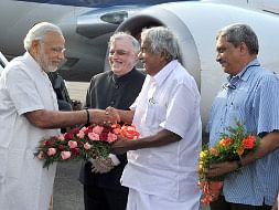 Prime Minister Narendra Modi being received by Kerala Governor Justice (Retd.) P. Sathasivam, Chief Minister Oommen Chandy and Union Defence Minister Manohar Parrikar, on his arrival in Kochi on December 14, 2015.