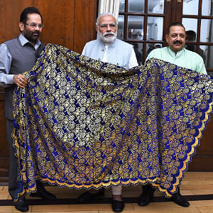 Prime Minister Narendra Modi handing over Chaadar to be offered at Dargah Khwaja Moinuddin Chishti Ajmer Sharif to Union Ministers Mukhtar Abbas Naqvi and Jitendra Singh, in New Delhi on March 24, 2017.