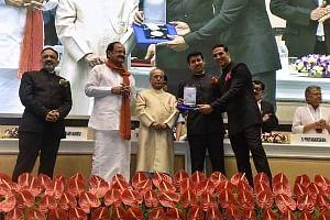 Bollywood star Akshay Kumar receiving the Best Actor Award from President Pranab Mukherjee at the 64th National Film Awards ceremony in New Delhi on May 3, 2017.
