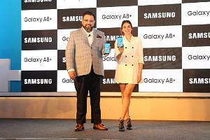 Aditya Babbar, General Manager, Mobile Business, Samsung India and actress Aditi Rao Hydari at the launch of the Galaxy A8+ smarphone, in New Delhi on January 10, 2018.