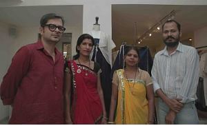 Designers Amit Vijaya and Richard Pandav with artisans from Rajasthan. (Photo: IANS)