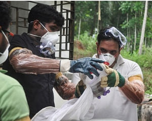 Medical staff wearing protective suit to avoid contacting Nipah virus that has claimed 16 lives in Kerala till now, in Kozhikode on May 25, 2018. (Photo: IANS)