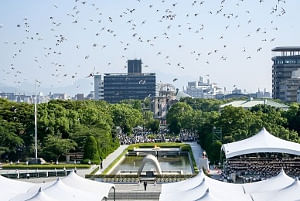 Pigeons fly over the Peace Memorial Park in Hiroshima, Japan, on Augist 6, 2018. Japan on Monday marked the 73rd anniversary of the atomic bombing of Hiroshima. (Xinhua/Ma Caoran/IANS)