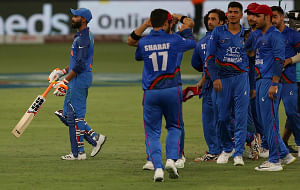 Afghanistan cricketers celebrate after the fifth match of Asia Cup 2018 Super Four between India and Afghanistan ended in a tie at Dubai International Cricket Stadium in Dubai, UAE on September 25, 2018. (Photo: Surjeet Yadav/IANS)