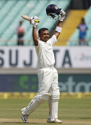 India's Prithvi Shaw celebrates his century during the 1st Test match between India and West Indies at Saurashtra Cricket Association Stadium in Rajkot on October 4, 2018. (Photo: Surjeet Yadav/IANS)