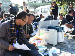 Polling officials checking Electronic Voting Machines on the eve of Mizoram Assembly elections, at a distribution centre at Pachhunga University College in Aizawl, Mizoram on November 27, 2018.