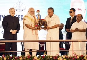 Prime Minister Narendra Modi with Kerala Chief Minister Pinarayi Vijayan at the inauguration of the Kollam Bypass on NH 66, in Kollam, Kerala on January 15, 2019.