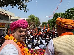 BJP chief Amit Shah during a roadshow ahead of 2019 Lok Sabha elections in Gandhinagar, Gujarat on March 30, 2019. (Photo: IANS)