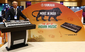 Yamaha Music India Managing Director Takashi Haga with the company's first Made in India PSR 1500 keyboard with Indian instrumental tunes.