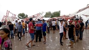 People gathered at the site where a massive tent erected for people attending a religious gathering collapsed during a dust storm in Rajasthan's Barmer, on June 23, 2019. (Photo: IANS)