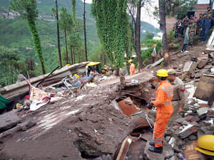Rescue operations underway at the site where a roadside three-storey eatery caved in owing to heavy rains at Kumarhatti in Himachal Pradesh's Solan district on July 14, 2019. (Photo: IANS)