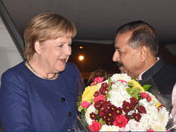 German Chancellor Angela Merkel being received by Minister of State in PMO Jitender Singh on her arrival at the Indira Gandhi International Airport in New Delhi on October 31, 2019.