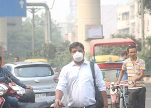 People wearing masks to protect themselves from air pollution in Delhi, on November 4, 2019.