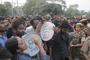 JNU students taunt cops, confine minister