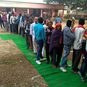 File photo of voters queueing outside a polling station in Jharkhand in the first phase of polling  in the elections to the state legislative assembly on November 30, 2019.