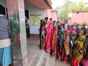 Voters queueing up at a polling station in Deoghar to cast their votes during the fourth phase of votiing in the Jharkhand Assembly elections, on December 16, 2019. (Photo: IANS/PIB)