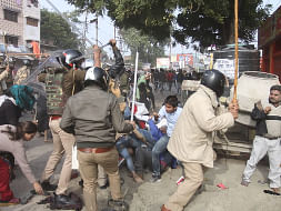 Police baton charging protesters to disperse them during a demonstration against the Citizenship Amendment Act (CAA) 2019, in Lucknow on December 19, 2019.
