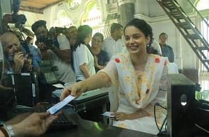 Actress Kangana Ranaut issues tickets at the Chhatrapati Shivaji Maharaj Terminus ahead of the trailer launch of her upcoming film