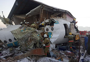 Rescuers work at the air crash site near Almaty, Kazakhstan on December 27, 2019. At least 12 people were killed after a plane of Kazakh airline Bek Air with 100 people on board crashed near Almaty. (Kazakhstan Interior Ministry Emergency Situations Committee/Xinhua/IANS)