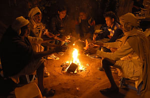 People warming themselves around a fire on a cold night in Jaipur, Rajasthan. (Photo: Ravi Shankar Vyas/IANS)