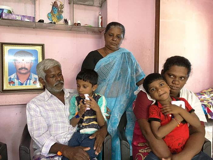 The family of slain RSS worker Rajesh (pictured in the frame)