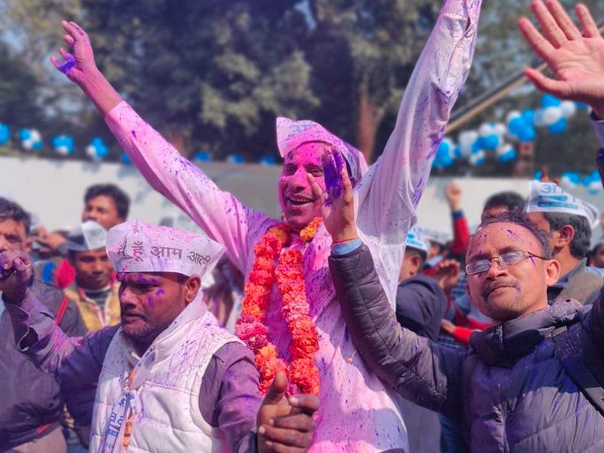 'Dawn of a new era in Indian politics': A day of jubilation at AAP's office in Delhi