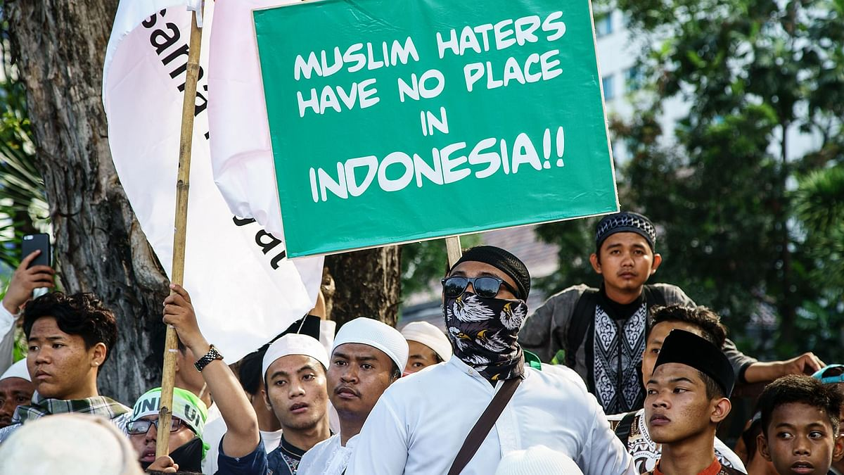 Indonesian protesters demand that Governor Basuki Tjahaja Purnama of Jakarta be arrested for blasphemy.