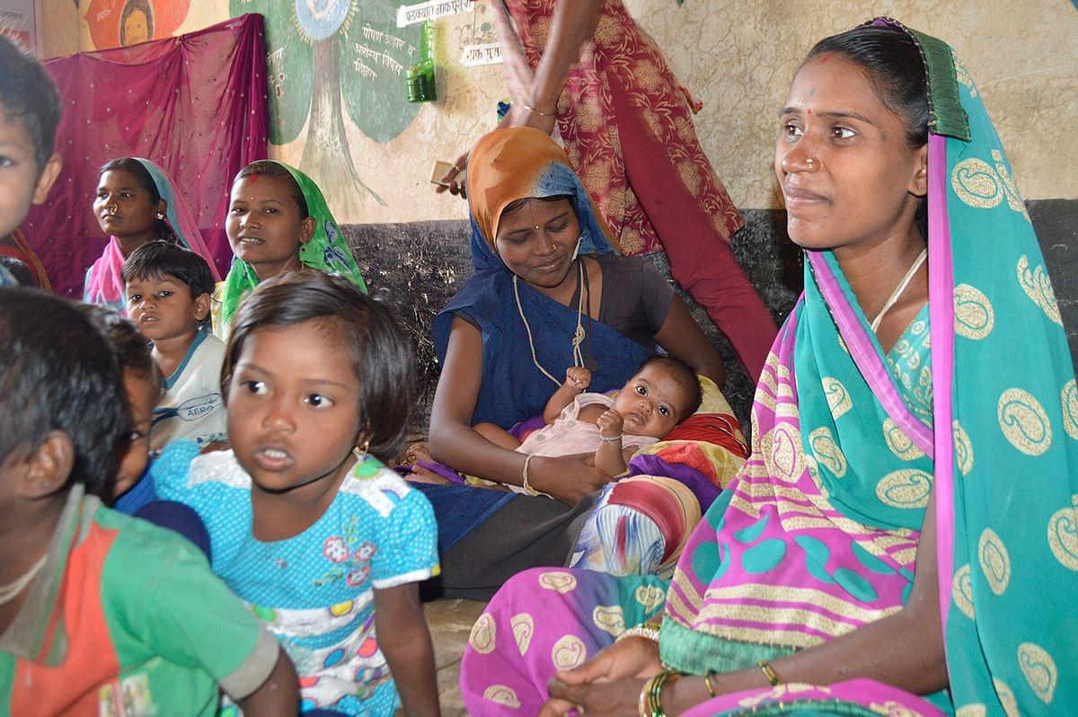 Pregnant Adivasi women at an anganwadi in Dharni.
