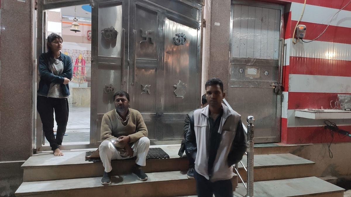 Priest Sudhanshu Sharma and Manoj Singh at the Shiv temple in Brijpur.