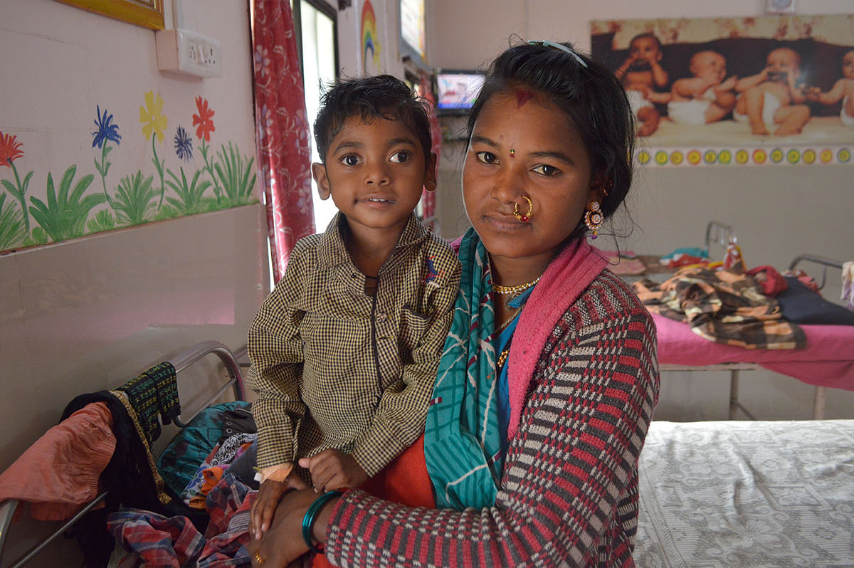 A Korku woman and her malnourished son in Dharni taluka.