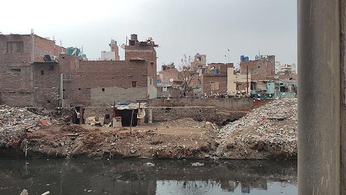 The Gokulpuri slum and the drain beside it.