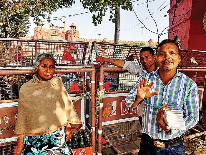 Taranjeet Singh and her two sons sell books outside Red Fort.