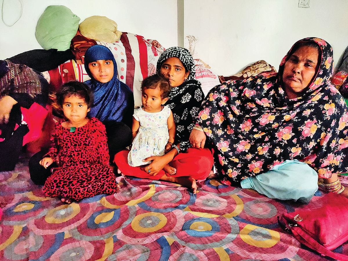 Chandni, left, with her family.