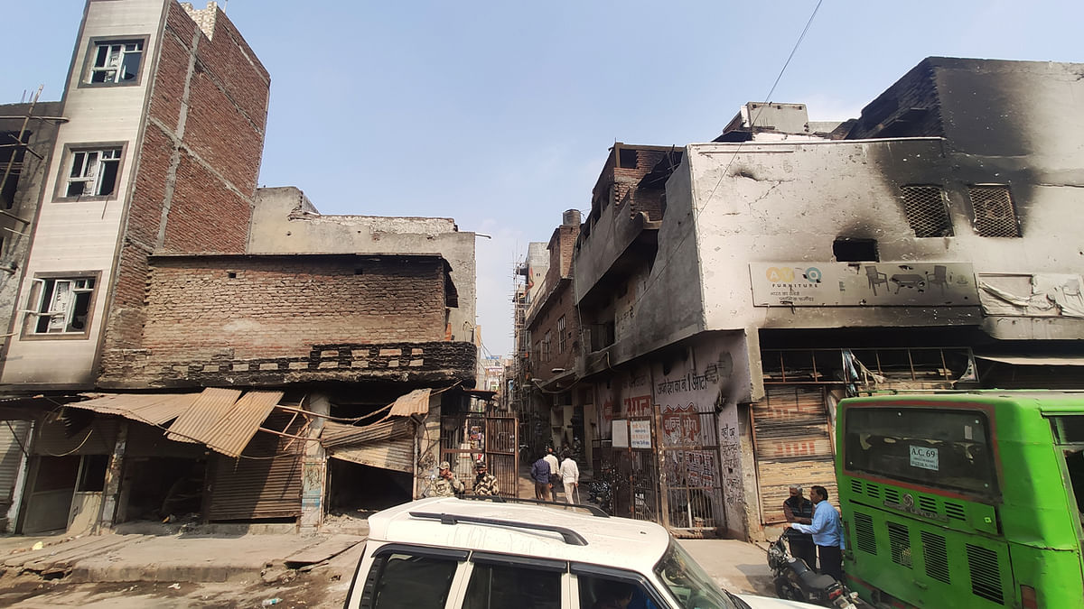 Gali Number 5, Moonga Nagar, opposite Tahir Hussain's house. The Hindus occupied the rooftops on the left and Muslim those on the right. They threw stones and petrol bombs at each other.
