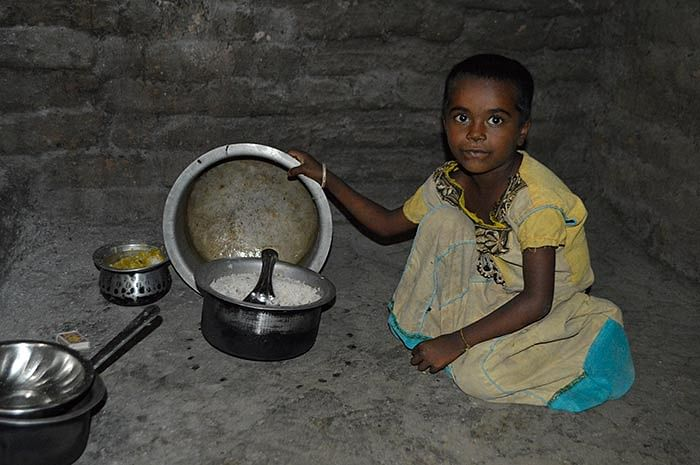 Priyanka, 6, shows the meal prepared by her mother before she left for work.