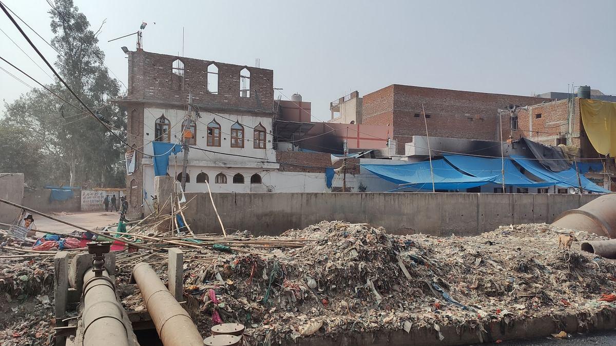 The burnt mosque beside Arun Modern Public School in Brijpur.