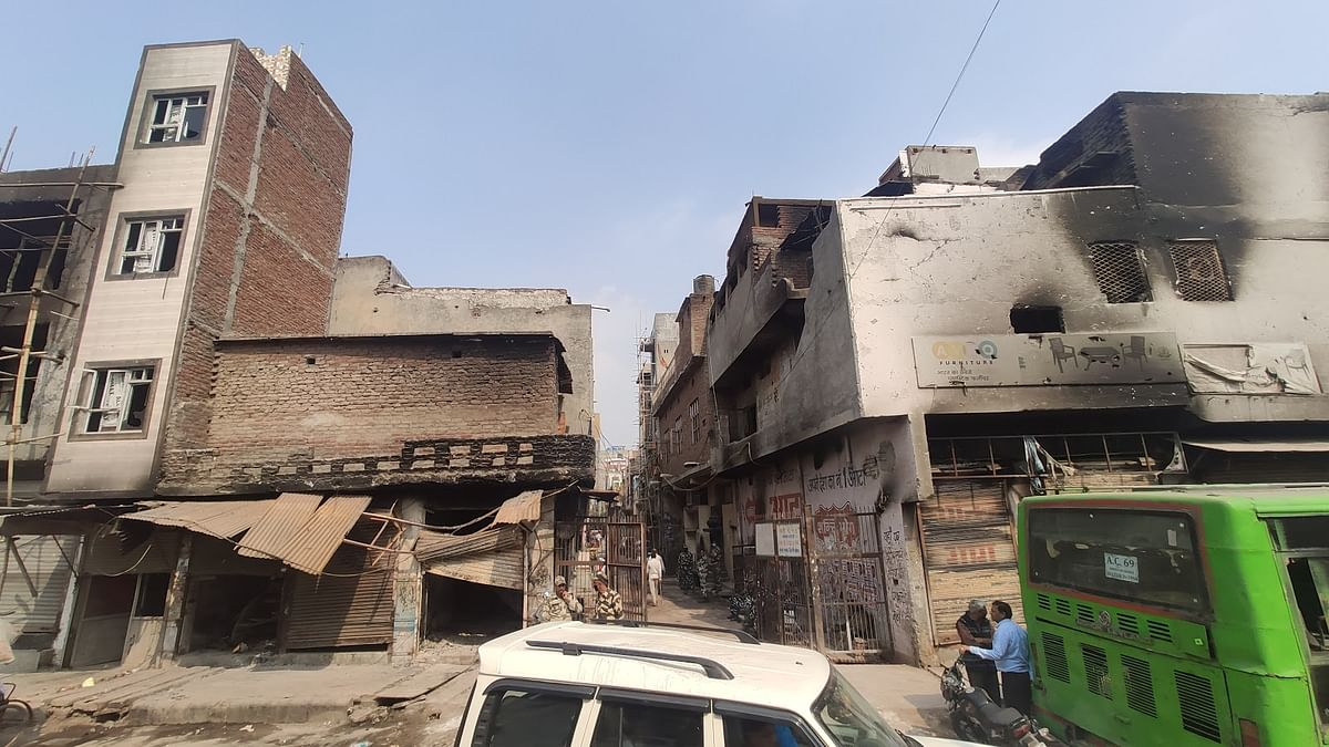 The temple lane in Moonga Nagar. The Hindus occupied the rooftops on the left and Muslim those on the right. They threw stones and petrol bombs at each other.