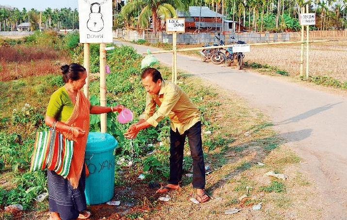 Villagers ensuring hand wash for outsiders in Bairagipara, Tripura.