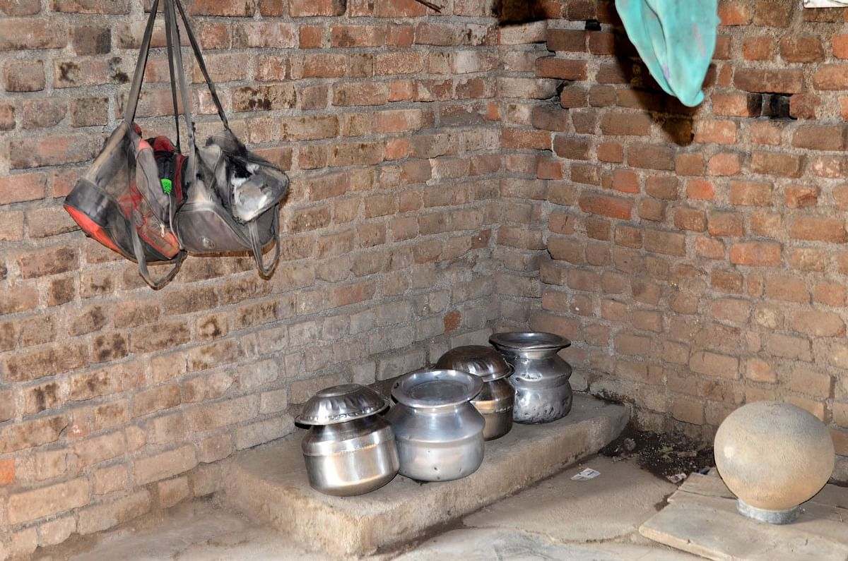 Utensils and the brick-lined stove in Shevanta's one-room home. She fears that her husband will marry again and then abandon her.