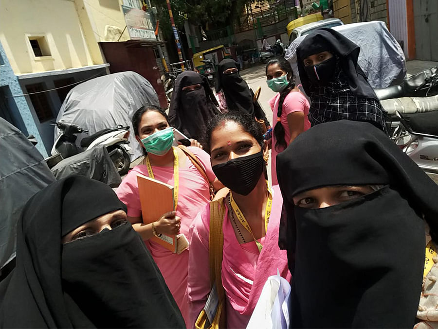 Nagalaxmi (left, in pink) in Bengaluru during a survey